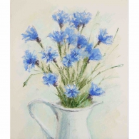 Cornflowers in white vase